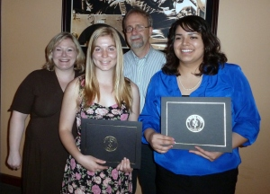 Professors Dari Sylvester and Brian E. Klunk welcome Faith James and Yeni Gutierrez to Pi Sigma Alpha.